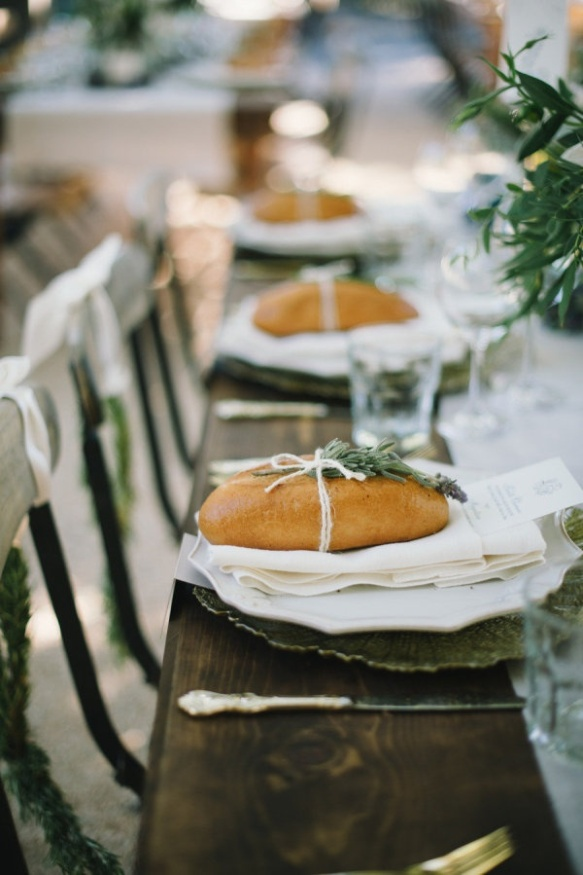 This wedding was a stunner! The couple gave each guest baguettes as favors to take home. And to embellish those delicious favors? Rosemary.  (via SMP, Planning Soiree by Simone Lennon, Photo by Delbarr Moradi Photography)